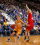 BROOKINGS, SD - FEBRUARY 21:  Macy Miller #12 from South Dakota State drives against Nicole Seekamp #35 from the University of South Dakota in the second half of their game Saturday evening at Frost Arena in Brookings. (Photo by Dave Eggen/Inertia)