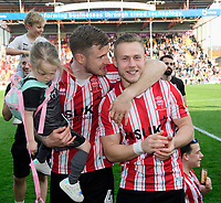 Lincoln City's Michael O'Connor, left, and Danny Rowe, celebrate after winning the league<br /> <br /> Photographer Chris Vaughan/CameraSport<br /> <br /> The EFL Sky Bet League Two - Lincoln City v Tranmere Rovers - Monday 22nd April 2019 - Sincil Bank - Lincoln<br /> <br /> World Copyright © 2019 CameraSport. All rights reserved. 43 Linden Ave. Countesthorpe. Leicester. England. LE8 5PG - Tel: +44 (0) 116 277 4147 - admin@camerasport.com - www.camerasport.com