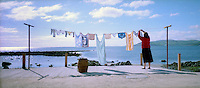 Oh what a beautiful morning! A housewife hangs out her washing at the rear of her Co Antrim cottage on the shoreline between the villages of Carnlough and Waterfoot. Her panoramic view is of the North Channel of the Irish Sea. 19905006921<br />
