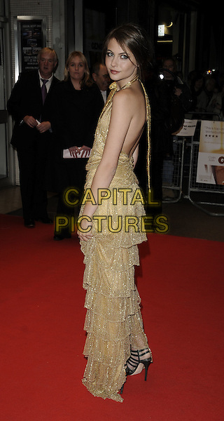 "WILLA HOLLAND .The ""Genova"" UK premiere, London Film Festival, Day 8, Odeon West End cinema, London, England..October 22nd, 2008.LFF full length gold sleeveless dress layers layered bow looking over shoulder halterneck.CAP/CAN.©Can Nguyen/Capital Pictures."