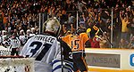 NASHVILLE, TN - OCTOBER 24:  Fans of the Nashville Predators celebrate with Predators forward Craig Smith #15 after his overtime game winning goal against goalie Ondrej Pavelec #31 of the Winnipeg Jets at Bridgestone Arena on October 24, 2013 in Nashville, Tennessee.  (Photo by Frederick Breedon/Getty Images)