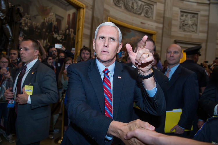 UNITED STATES - MAY 23: Vice President Mike Pence greets visitors in the Capitol rotunda after attending the Senate Republican Policy luncheon on May 23, 2017. (Photo By Tom Williams/CQ Roll Call)