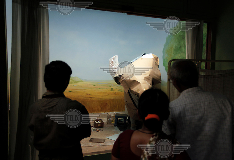 Natural history section at the The Prince of Wales Museum of Western India, with tourists watching an unfinished display.