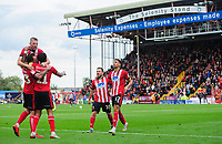 Lincoln City's Tyler Walker, right, celebrates scoring his side's second goal with team-mates, from left, Neal Eardley, Joe Morrell, Bruno Andrade and Jack Payne<br /> <br /> Photographer Chris Vaughan/CameraSport<br /> <br /> The EFL Sky Bet League One - Lincoln City v Sunderland - Saturday 5th October 2019 - Sincil Bank - Lincoln<br /> <br /> World Copyright © 2019 CameraSport. All rights reserved. 43 Linden Ave. Countesthorpe. Leicester. England. LE8 5PG - Tel: +44 (0) 116 277 4147 - admin@camerasport.com - www.camerasport.com
