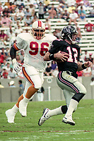 Tim Newton, #96, Tampa Bay Bucs, causes Chris Miller, #12 Atlanta Falcons, Atlanta Falcons at Tampa Bay Buccaneers.  The Bucs beat the Falcons 23-17  at Tampa Stadium on December 2, 1990, Tampa, Florida.  (Photo by Brian Cleary/bcpix.com)