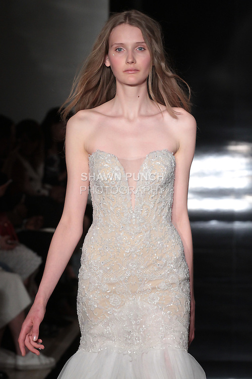 Model walks runway in an embroidered strapless gown with tulle skirt and sweeping back train, from the Reem Acra Spring 2017 bridal collection, during New York Bridal Fashion Week Spring Summer 2017, on April 15, 2016.