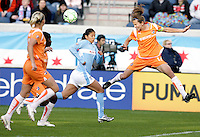 Sky Blue FC defender Keeley Dowling (17) heads away a long cross in front of Chicago Red Star forward Cristiane (11).  The Sky Blue FC defeated the Chicago Red Stars 2-0 at Toyota Park in Bridgeview, IL on May 10, 2009.