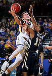BROOKINGS, SD - FEBRUARY 4:  	Mike Daum #24 from South Dakota State University is fouled while taking then all to the basket by Aaron Anderson #13 from Oral Roberts during their game Saturday afternoon at Frost Arena in Brookings.(Photo by Dave Eggen/Inertia)