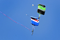 NWA Democrat-Gazette/BEN GOFF @NWABENGOFF<br /> Brandon Cawood (top) and father Terry Cawood with Skydive Skyranch in Siloam Springs take part in a demonstration dive on Saturday Sept. 12, 2015 during the Sheep Dog Impact Assistance annual Patriot Day event at Bentonville Municipal Airport. The event honored the victims of the Sept. 11, 2001 terrorist attacks and offered visitors a chance to get an up close look at military and emergency response vehicles.