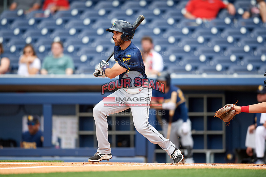 New Orleans Baby Cakes second baseman Steve Lombardozzi (4) follows through on a swing during a game against the Nashville Sounds on April 30, 2017 at First Tennessee Park in Nashville, Tennessee.  The game was postponed due to inclement weather in the fourth inning.  (Mike Janes/Four Seam Images)