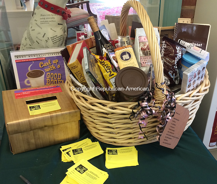 KENT, CT – 04 February 2014 - 020414LMW01 – This basket of chocolate-related goodies is going to go to an adult reader from Kent. Adults may fill out a yellow prize ticket at Kent Memorial Library for each book they read or listen to this month, which will be entered into a drawing Feb. 28 for the basket. Lynn Mellis Worthington Republican-American