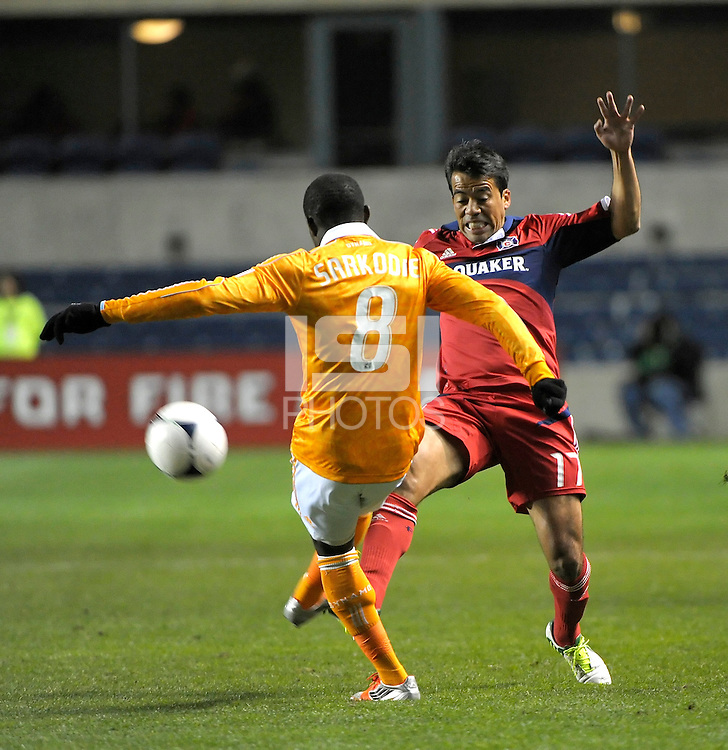 Chicago midfielder Pavel Pardo (17) tries to prevent a pass by Houston defender Kofi Sarkodi (8).  The Houston Dynamo defeated the Chicago Fire 2-1 in the Eastern Conference play-in game for the MLS Playoffs at Toyota Park in Bridgeview, IL on October 31, 2012.