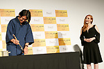 Japanese calligraphy (Kanji) artist Soun Takeda (L) writes a message for Jessica Chastain (R) during a stage greeting for the film The Zookeeper's Wife on November 27, 2017, Tokyo, Japan. Chastain greeted fans during the promotional event for the movie which will be released in Japan on December 15. (Photo by Rodrigo Reyes Marin/AFLO)
