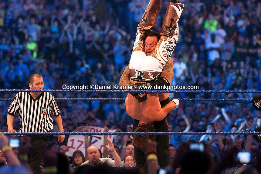 The Undertaker is about to drop Shawn Michaels on his head in a move known as the Tombstone at WrestleMania 25 at Reliant Stadium on April 5, 2009 in Houston, Texas.