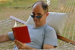 Mid adult man reading book, portrait