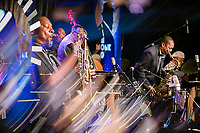 An in-camera 4-photo multiple exposure of Ravi Coltrane playinhg the tenor saxophone with the Ethan Iverson Trio for Thelonious Monk's 100th birthday for during the Monk @ 100 festival at the Durham Fruit and Produce Company in Durham, NC Thursday, October 26, 2017. (Justin Cook for The New York Times)