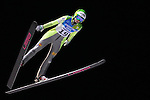 Katja Pozun competes during the Normal Hill Ski Jumping event as part of the Winter Universiade Trentino 2013 on 14/12/2013 in Predazzo, Italy.<br /> <br /> &copy; Pierre Teyssot - www.pierreteyssot.com
