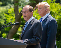 United States Secretary of Health and Human Services Alex Azar makes remarks about a &quot;new blueprint&quot; for lowering prescription drug prices in the Rose Garden of the White House in Washington, DC on Friday, May 11, 2018.  US President Donald J. Trump looks on from right.CAP/MPI/RS<br /> &copy;RS/MPI/Capital Pictures