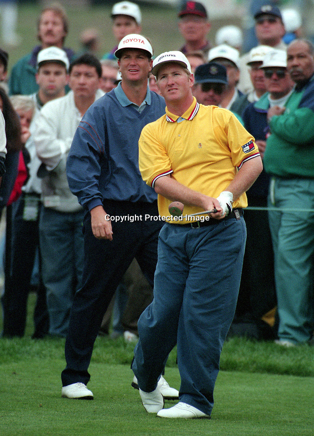 David Duval with Peter Jacobson behind him..playing in the 1995 AT&T golf at Pebble Beach. (Ron Riesterer/photo)