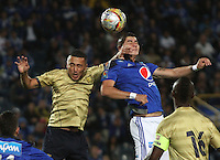 BOGOTA - COLOMBIA - 30-08-2015: Michael Rangel jugador de Millonarios  disputa el balon con Esteban Castaneda de Aguilas Doradas    durante partido  por la fecha 9 de la Liga Aguila II 2015 jugado en el estadio Nemesio Camacho El Campin . /Michael Rangel  player of Millonarios fights the ball against Esteban Castaneda of Aguilas Doradas during a match for the ninth date of the Liga Aguila II 2015 played at Nemesio Camacho El Campin stadium in Bogota  city. Photo: VizzorImage / Felipe Caicedo / Staff.