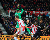 2nd December 2017, bet365 Stadium, Stoke-on-Trent, England; EPL Premier League football, Stoke City versus Swansea City; Lukasz Fabianski of Swansea City claims the ball from the challenge of Peter Crouch of Stoke City