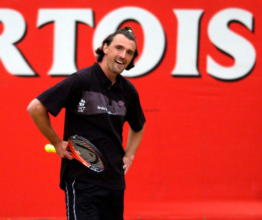 Photo. Jed Wee..Stella Artois Championships. .12/06/2005..Goran Ivanisevic entertains the crowd in an exhibition game against John McEnroe.