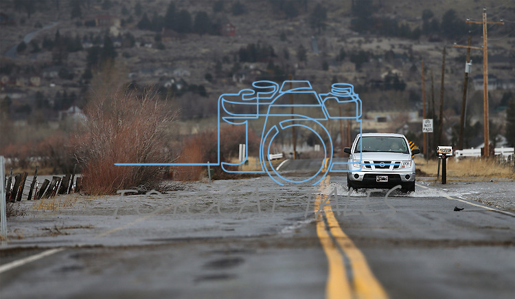 Law enforcement was ticketing drivers for driving around road closure signs as the northern Nevada region sees widespread flooding and damage from a series storms on Monday, Jan. 9, 2017. <br /> Photo by Cathleen Allison/Nevada Photo Source