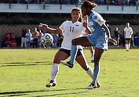 SAN DIEGO, CA - DECEMBER 02, 2012:  Crystal Dunn (19) of the University pokes the ball past Raquel Rodriguez (11) of North Carolina of Penn State University during the NCAA 2012 women's college championship match, at Torero Stadium, in San Diego, CA, on Sunday, December 02 2012. Carolina won 4-1.