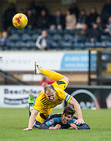 Mark McChrystal of Bristol Rovers bundles Michael Harriman of Wycombe Wanderers over as the goes clear on goal during the Sky Bet League 2 match between Wycombe Wanderers and Bristol Rovers at Adams Park, High Wycombe, England on 27 February 2016. Photo by Andy Rowland.