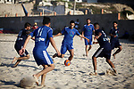 Palestinian players compete in a beach ball match during a local competition, at the beach of the Mediterranean sea, west of Gaza city on June 15, 2019. Photo by Mahmoud Ajjour