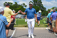 Jon Rahm (ESP) fist bumps fans on his way to the tee on 10 during round 1 of the 2019 Charles Schwab Challenge, Colonial Country Club, Ft. Worth, Texas,  USA. 5/23/2019.<br /> Picture: Golffile | Ken Murray<br /> <br /> All photo usage must carry mandatory copyright credit (© Golffile | Ken Murray)