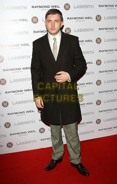 Ben Drew aka Plan B.Raymond Weil Pre Brits Dinner at Mozaica, Wood Green, London, England..January 26th 2012.full length black coat jacket grey gray trousers.CAP/ROS.©Steve Ross/Capital Pictures