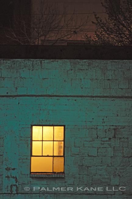 Urban window light on a dark night
