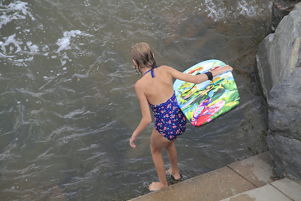 Young girl going for a swim in Boulder Creek, Boulder, Colorado. .  John offers private photo tours in Denver, Boulder and throughout Colorado. Year-round Colorado photo tours.