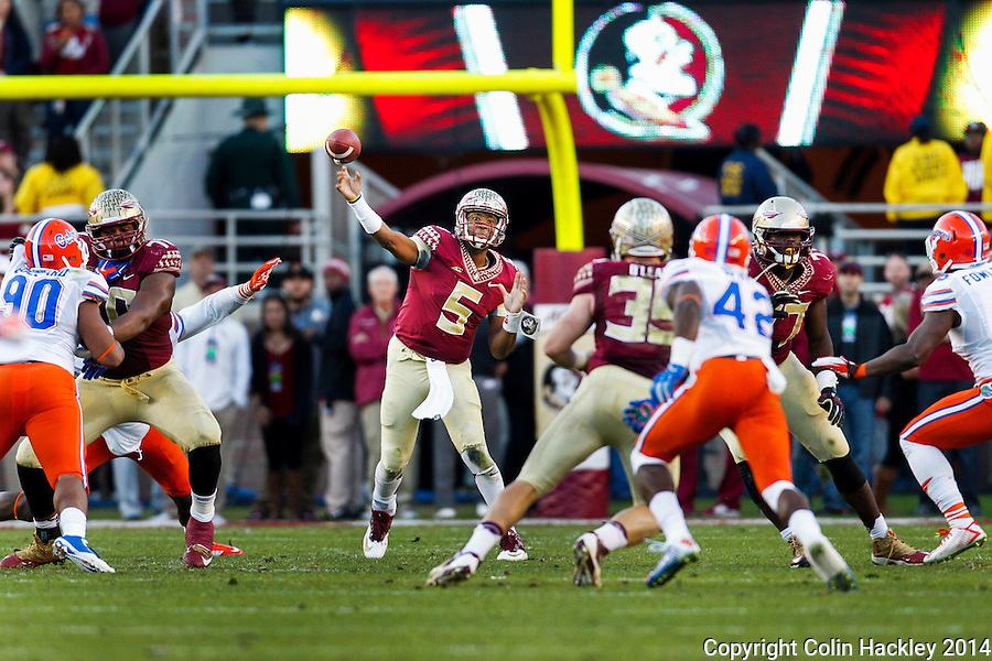 TALLAHASSEE, FL 11/29/14 FSU-UF112914-Florida State quarterback Jameis Winston passes against the University of Florida during first half action Saturday at Doak Campbell Stadium in Tallahassee. <br /> COLIN HACKLEY PHOTO