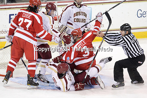 Yasin Cissé (BU - 27), Patch Alber (BC - 3), Tommy Cross (BC - 4), Charlie Coyle (BU - 3), Bob Bernard - The visting Boston University Terriers defeated the Boston College Eagles 5-3 (EN) on Friday, December 2, 2011, at Kelley Rink in Conte Forum in Chestnut Hill, Massachusetts.