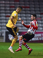 Lincoln City's Tom Pett vies for possession with  Wolverhampton Wanderers U21's Ryan Giles<br /> <br /> Photographer Andrew Vaughan/CameraSport<br /> <br /> The EFL Checkatrade Trophy Northern Group H - Lincoln City v Wolverhampton Wanderers U21 - Tuesday 6th November 2018 - Sincil Bank - Lincoln<br />  <br /> World Copyright © 2018 CameraSport. All rights reserved. 43 Linden Ave. Countesthorpe. Leicester. England. LE8 5PG - Tel: +44 (0) 116 277 4147 - admin@camerasport.com - www.camerasport.com