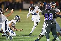NWA Democrat-Gazette/BEN GOFF @NWABENGOFF<br /> Jesus Barroso, with Blaise Wittschen holding, kicks a field goal for Springdale Har-Ber in the third quarter vs Fayetteville Friday, Nov. 8, 2019, at Harmon Stadium in Fayetteville.