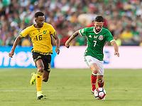 Pasadena, CA - Thursday June 09, 2016: Lee Williamson, Miguel Layun during a Copa America Centenario Group C match between Mexico (MEX) and Jamaica (JAM) at Rose Bowl Stadium.