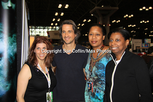 """General Hospital Michael Easton (One Life To Live, Port Charles, Days of Our Lives) and fans at the New York Comic Con 2012 to show fans and others """"Soul Stealer Collector's Edition"""" which he cowrote and  was in a booth with Christopher Shy on October 13, 2012 at the Javits Center, New York City, New York. (Photo by Sue Coflin/Max Photos)"""