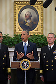 United States President Barack Obama (center) is flanked by Vice Admiral Vivek M. Murthy, United States Surgeon General (left) and Rear Admiral Boris Lushniak Officer-in-Charge of MMU Transition Between Teams (right) as he meets with members of the Public Health Service Commissioned Corps (PHS CC) after signing a citation awarding the Presidential Unit Citation to PHS CC members who participated in the Ebola containment efforts in West Africa, in the Oval Office at The White House in Washington, D.C., U.S., on Thursday, Sept. 24, 2015.<br /> Credit: Rod Lamkey Jr. / Pool via CNP