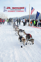 Emma Shawcroft leaves the start line at Knik during the start of the Junior Iditarod on Saturday February 25, 2017. <br /> <br /> <br /> Photo by Jeff Schultz/SchultzPhoto.com  (C) 2017  ALL RIGHTS RESVERVED