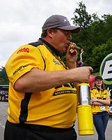 Jun 18, 2017; Bristol, TN, USA; NHRA pro mod driver Troy Coughlin Sr smokes a cigar as he celebrates after winning the Thunder Valley Nationals at Bristol Dragway. Mandatory Credit: Mark J. Rebilas-USA TODAY Sports