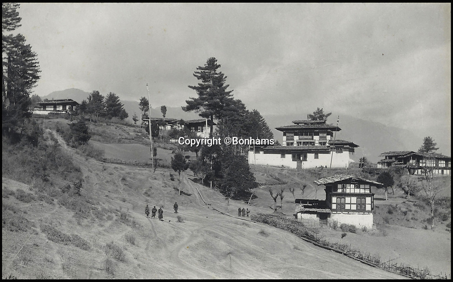 BNPS.co.uk (01202 558833)<br /> Pic: Bonhams/BNPS<br /> <br /> Gorina Monastery, surrounded by Lamas' houses, situated on a spur running into the Paro valley.<br /> <br /> Fascinating 112 year-old photographs of Bhutan taken decades before the remote country in the Himalayas became open to outsiders have been unearthed.<br /> <br /> The images provide an unprecedented insight into the isolated kingdom nestled between India and China in the heart of the Himalayas at the beginning of the 20th century. <br /> <br /> The country was almost completely cut off for centuries as it sought to protect its ancient traditions and has only become more accessible to visitors since the 1970s. Such has been their desire to protect their heritage they didn't have TV until 1999.<br /> <br /> The photographs are believed to have belonged to the family of someone who took part in the expedition to Bhutan in 1905 and have since been passed to a private collector.<br /> <br /> The present owner has now decided to submit them for auction and they are tipped to sell for £15,000.