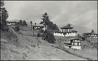 BNPS.co.uk (01202 558833)<br /> Pic: Bonhams/BNPS<br /> <br /> Gorina Monastery, surrounded by Lamas&rsquo; houses, situated on a spur running into the Paro valley.<br /> <br /> Fascinating 112 year-old photographs of Bhutan taken decades before the remote country in the Himalayas became open to outsiders have been unearthed.<br /> <br /> The images provide an unprecedented insight into the isolated kingdom nestled between India and China in the heart of the Himalayas at the beginning of the 20th century. <br /> <br /> The country was almost completely cut off for centuries as it sought to protect its ancient traditions and has only become more accessible to visitors since the 1970s. Such has been their desire to protect their heritage they didn't have TV until 1999.<br /> <br /> The photographs are believed to have belonged to the family of someone who took part in the expedition to Bhutan in 1905 and have since been passed to a private collector.<br /> <br /> The present owner has now decided to submit them for auction and they are tipped to sell for &pound;15,000.