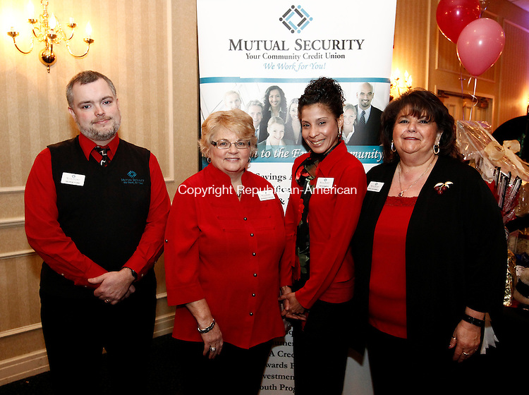 Southbury, CT-03 February 2012-020313CM10- SOCIAL MOMENTS:  From left to right, George Ford, Barbara Fortier, Rita Ramos, and Rita Ciccarelli from Mutual Security Credit Union photographed during the 20th annual Chocolate Lovers' Expo to benefit Easter Seals, at the Crowne Plaza Hotel in Southbury.  Christopher Massa Republican-American