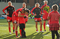 Portland, Oregon - Sunday October 2, 2016: Portland Thorns FC forward Christine Sinclair (12) hugs the Girls of the Game after receiving roses during a semi final match of the National Women's Soccer League (NWSL) at Providence Park.