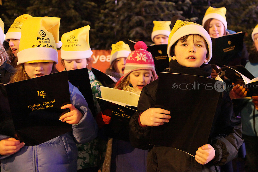 "NO REPRO FEE. 17/12/2010. Focus Ireland festive lights. CAChildren from the Piccolo Lasso Choir switched on the lights on the Christmas Tree at Grafton St. this evening (Fri Dec 17th) for the Focus Ireland ""Sponsor a Star"" campaign. EUR250,000 has been raised by businesses sponsoring a star on the landmark tree which is dedicated to people who are homeless. Picture James Horan/Collins Photos"