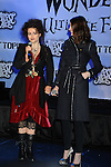 "HOLLYWOOD, CA. - February 19: Helena Bonham Carter and Anne Hathaway attends the ""Alice In Wonderland"" Great Big Ultimate Fan Event at Hollywood & Highland Courtyard on February 19, 2010 in Hollywood, California."