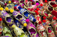 Traditional Turkish silk slippers ornate embroidered in the Misir Carsisi Egyptian Bazaar market in Istanbul, Turkey